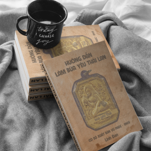 cup of coffee over books mockup on a bed a17405