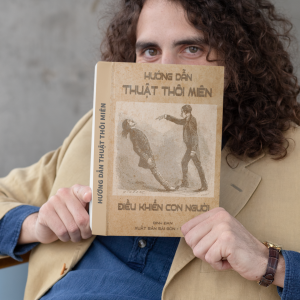 hardcover book mockup featuring a man covering his face 30924