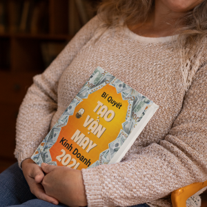 mockup of a woman happily holding a book 32215