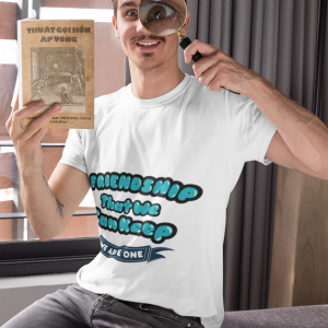 t shirt mockup of a man playing with a magnifying glass while holding a book 28501