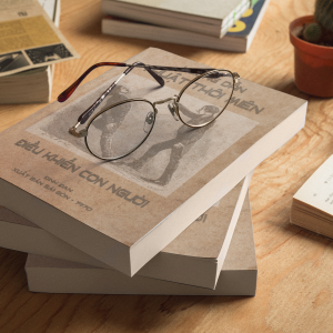 three books mockup lying on top of each other and round glasses a17407 1